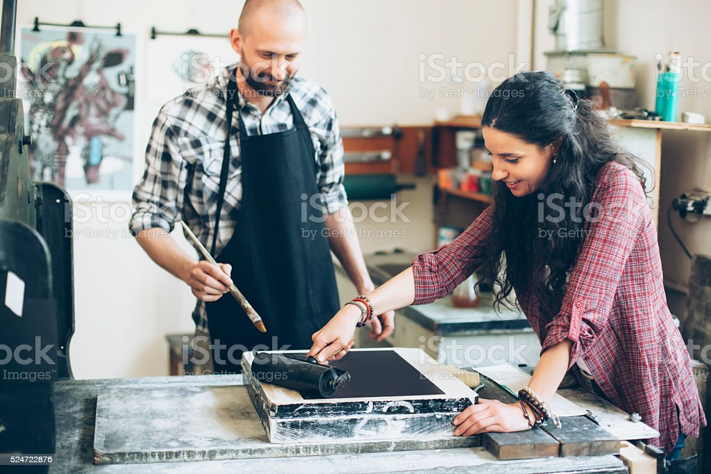 Lithography workers handmaking new pattern at workshop stock photo