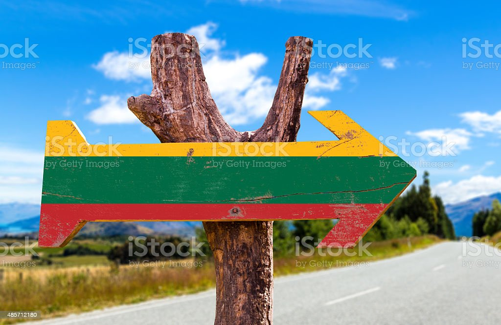 Lithuania Flag wooden sign with road background stock photo