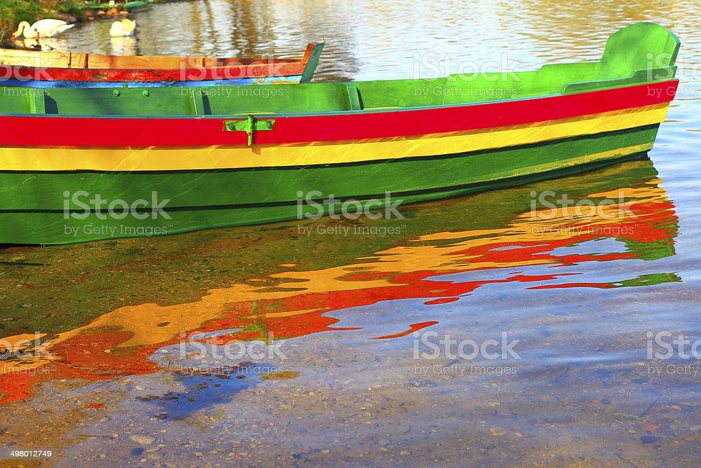Lithuanian boat flag and lake reflection, Trakai, Baltics stock photo