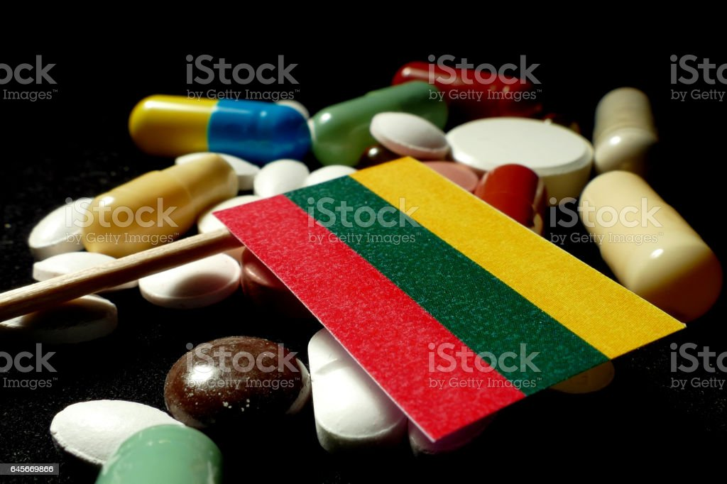 Lithuanian flag with lot of medical pills isolated stock photo