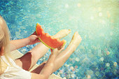 Litle girl with fresh watermelon.Summer time concept
