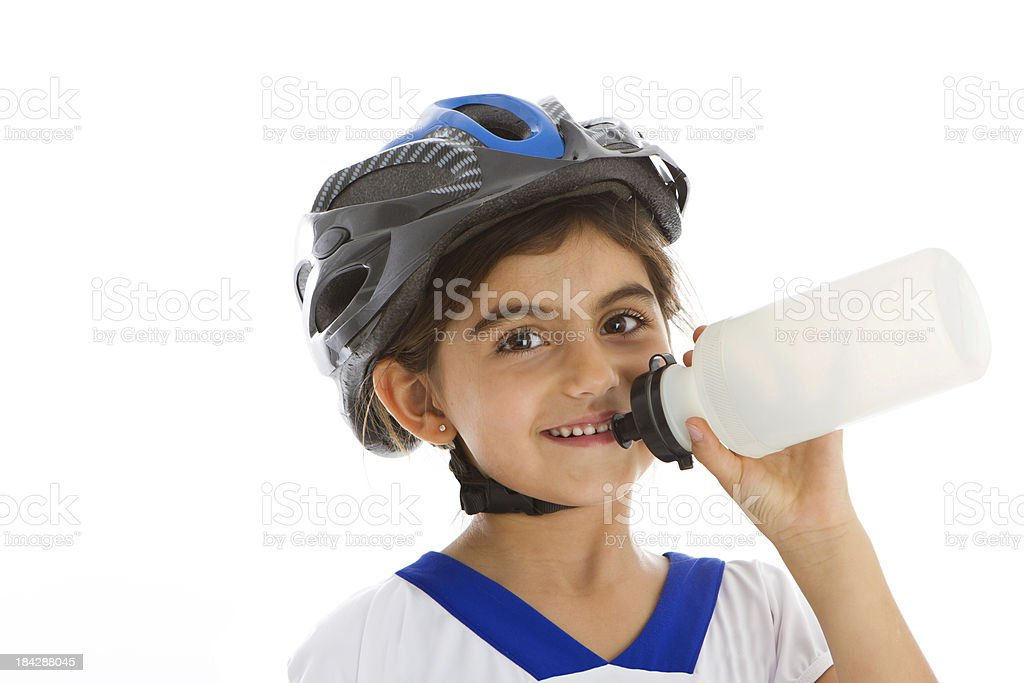 Litlle cyclist drinking water stock photo