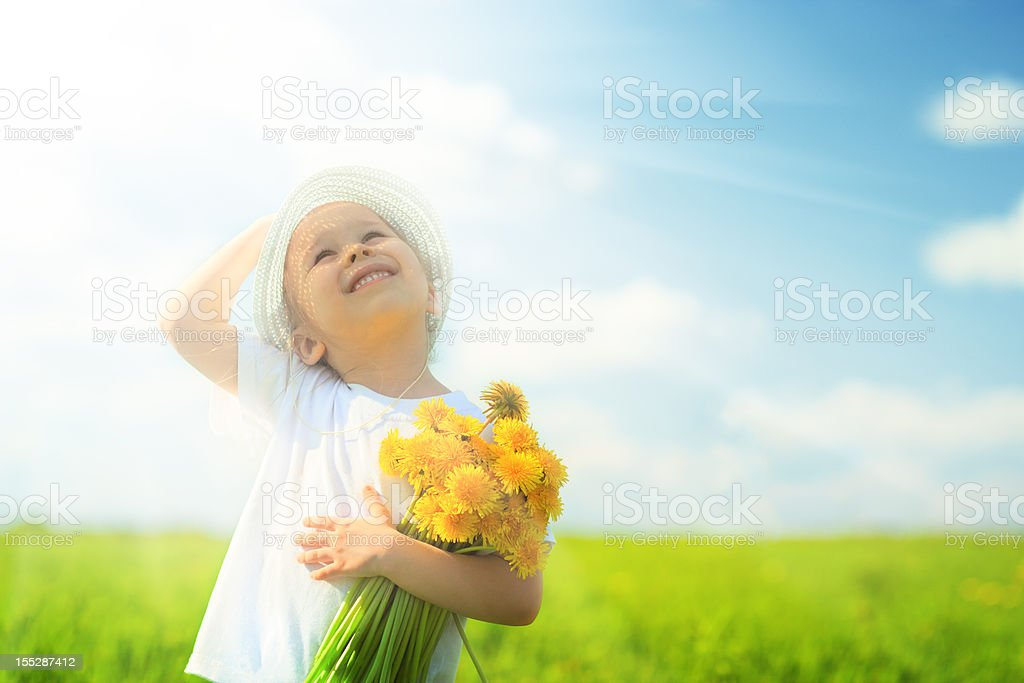 Litlle girl  on meadow royalty-free stock photo