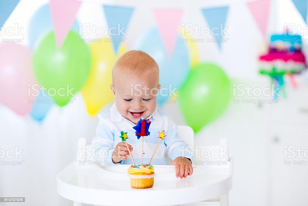 Litte boy celebrating first birthday stock photo
