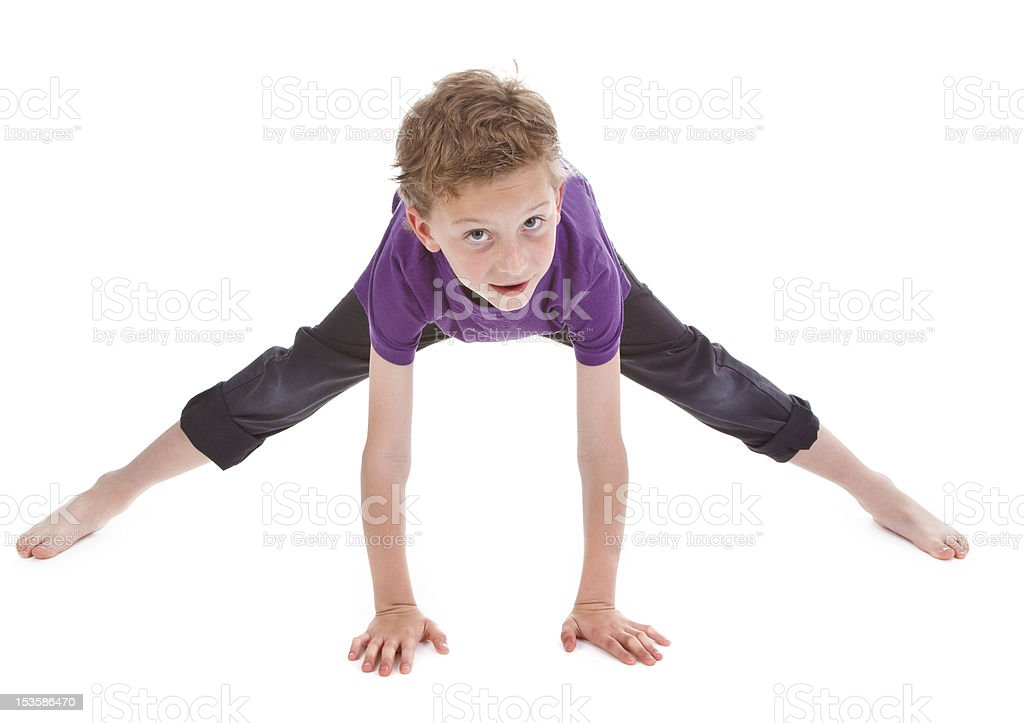 litte boy is trying to make spine stock photo