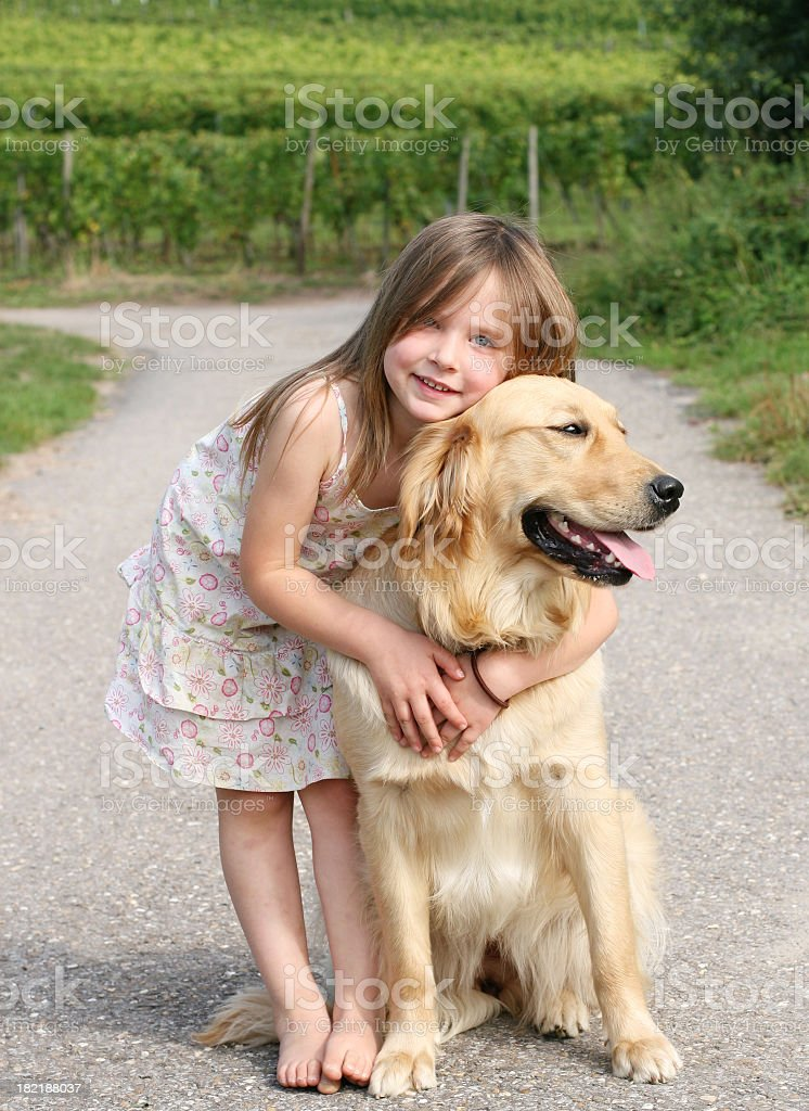 Litte girl and Golden Retriever royalty-free stock photo