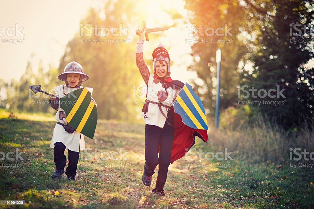 Litte knights charging stock photo
