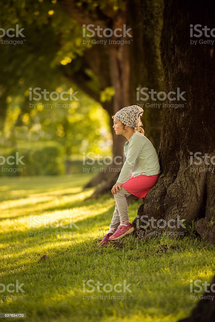 littel 6 year old girl in a park stock photo