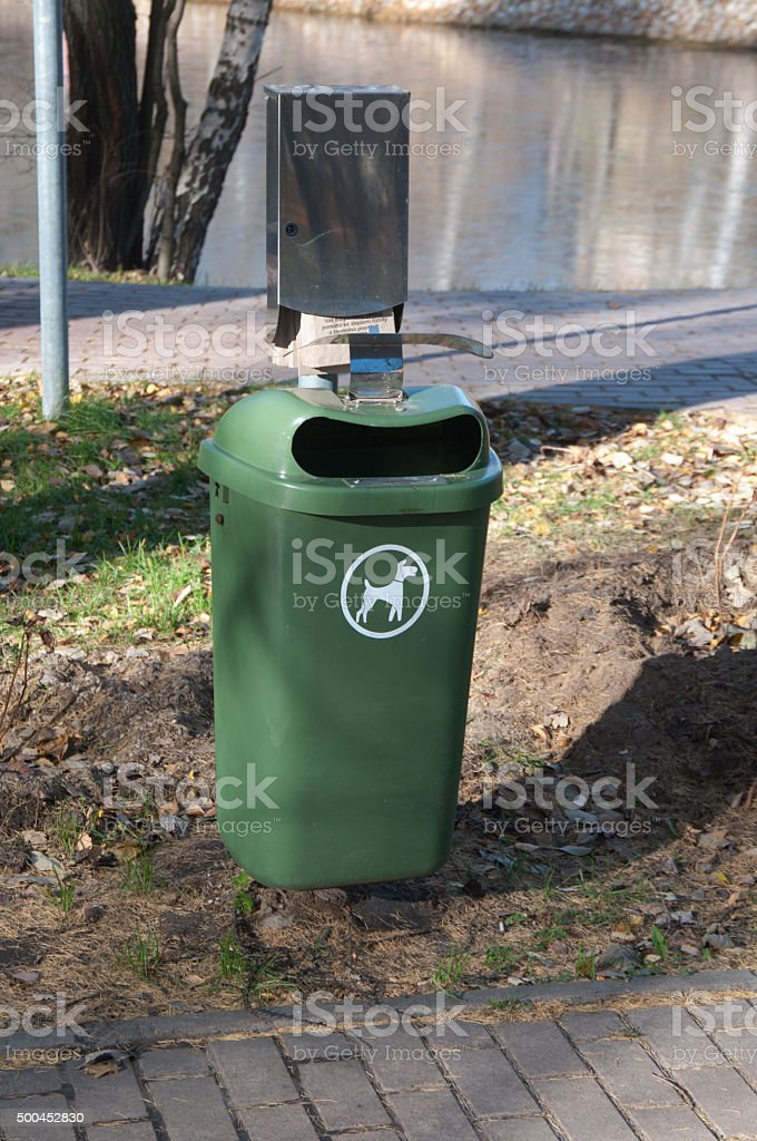 Litter basket for dog excrements stock photo