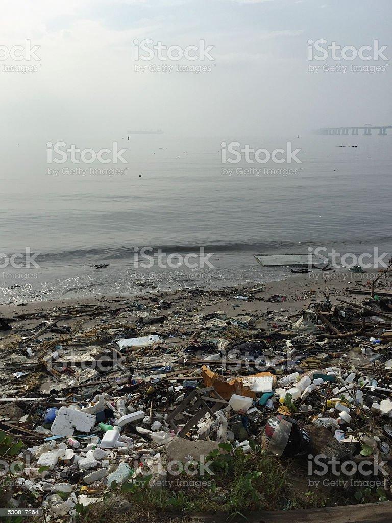 Littered beach Guanabara Bay royalty-free stock photo