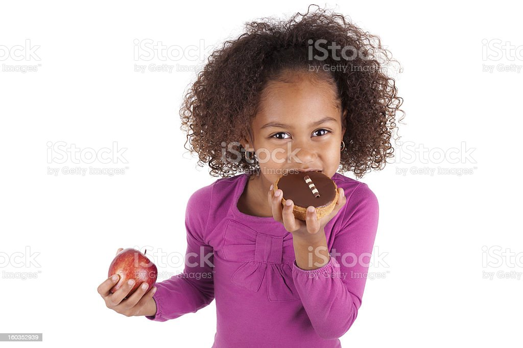 Little African Asian girl eating a chocolate cake royalty-free stock photo
