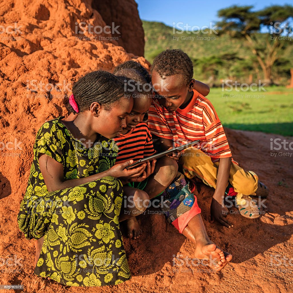 Little African children using digital tablet, East Africa stock photo