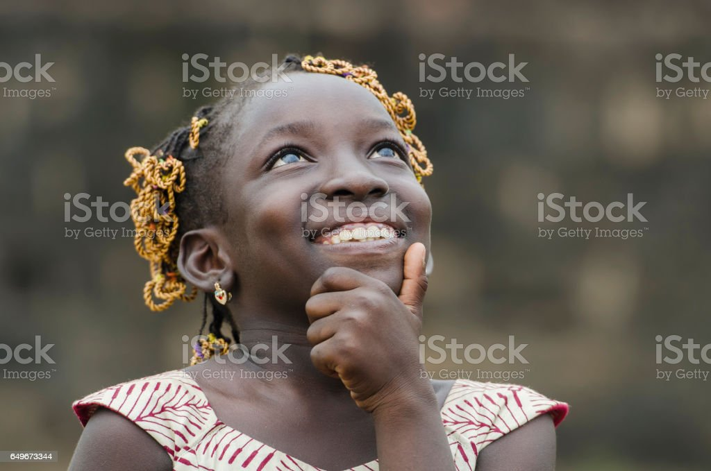 Little African Girl Thinking About Her Future on the Black Continent stock photo