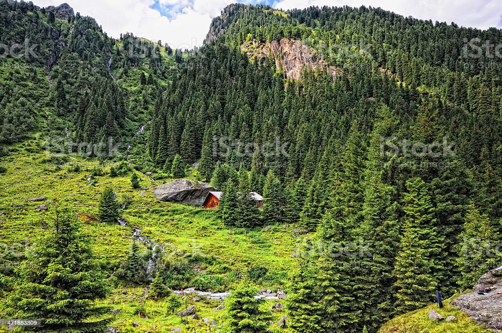 Little alpine Hovel at stream water (Zillertal Austria) royalty-free stock photo