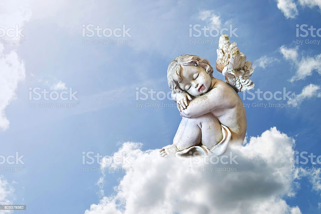 Little angel sleeping on the cloud stock photo