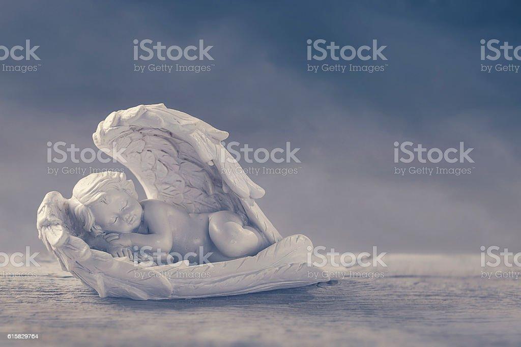 Little angel sleeping stock photo