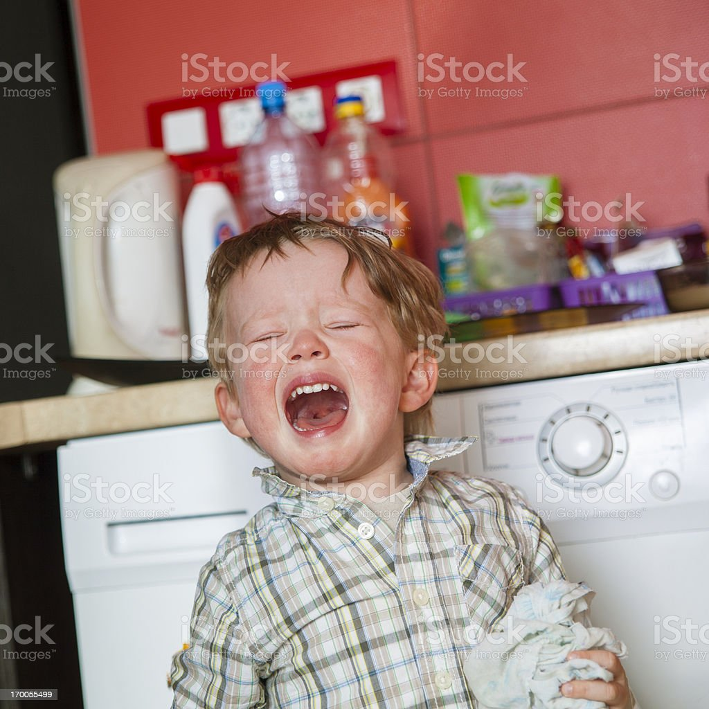 Little angry boy crying stock photo