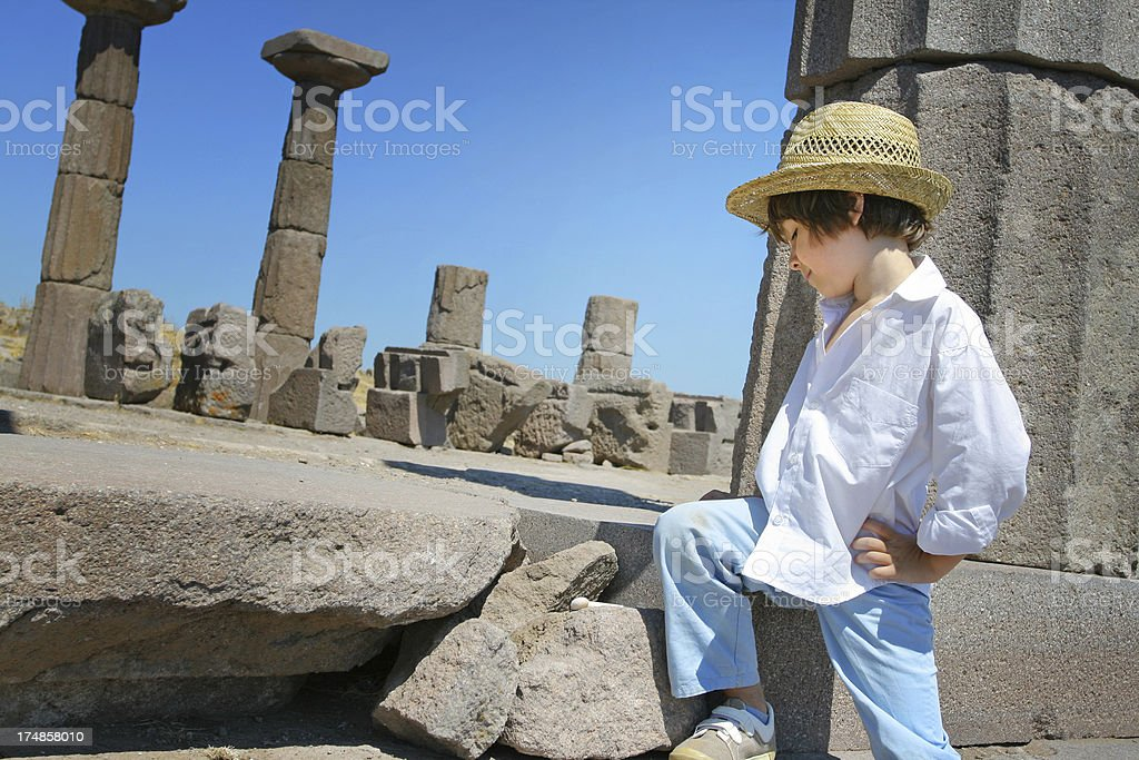Little archaeologist at site stock photo
