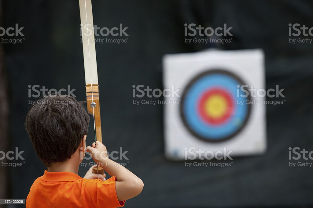 Little Archer holding bow, arrow and target stock photo