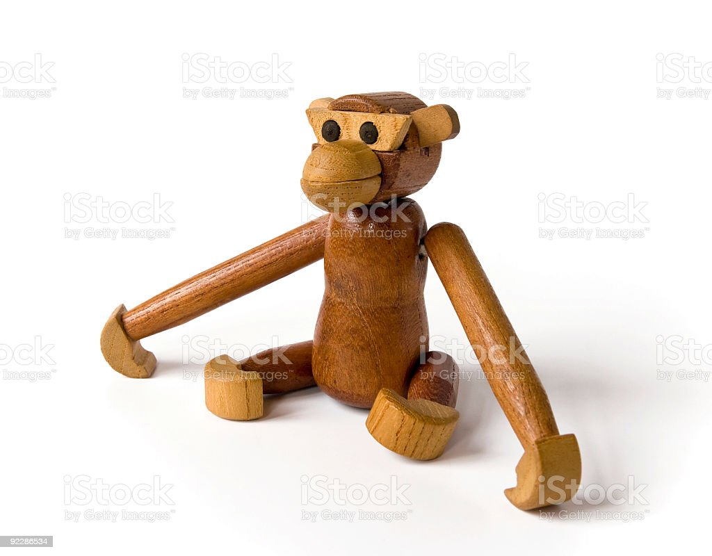 Little articulated wooden monkey royalty-free stock photo