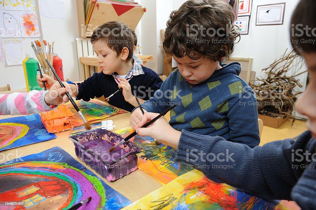 Little artist exhibiting his creativity stock photo