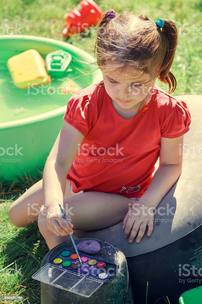 Little artist in summer garden. stock photo