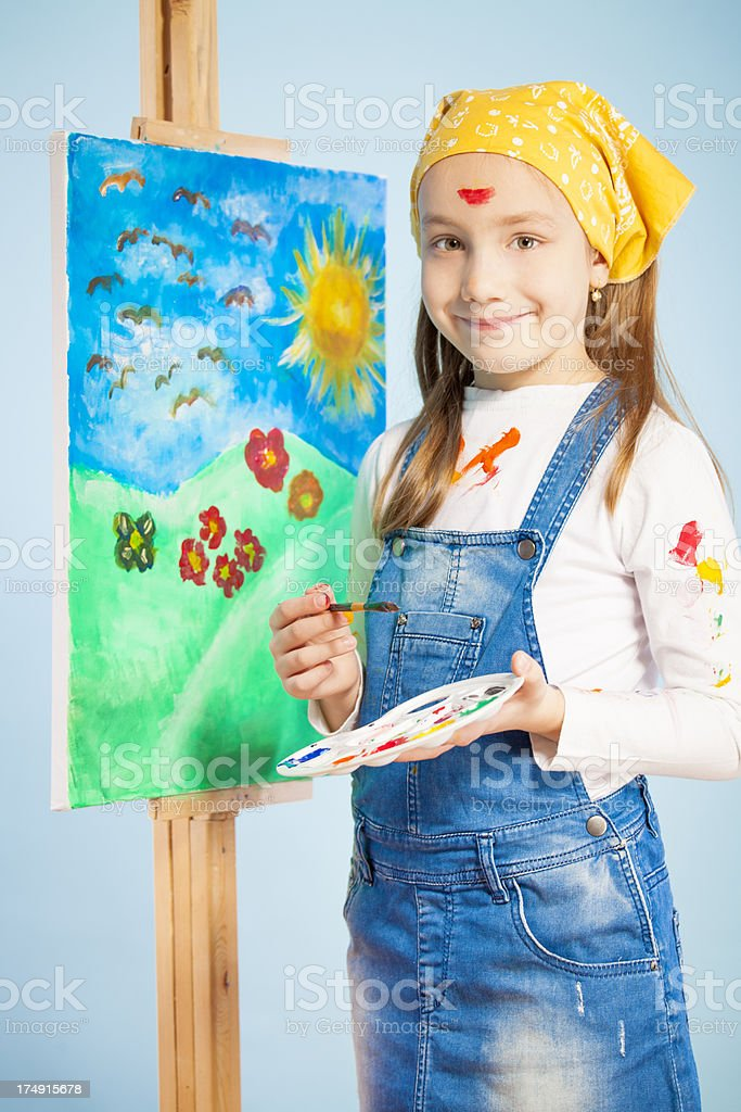 Little artist painting on canvas royalty-free stock photo