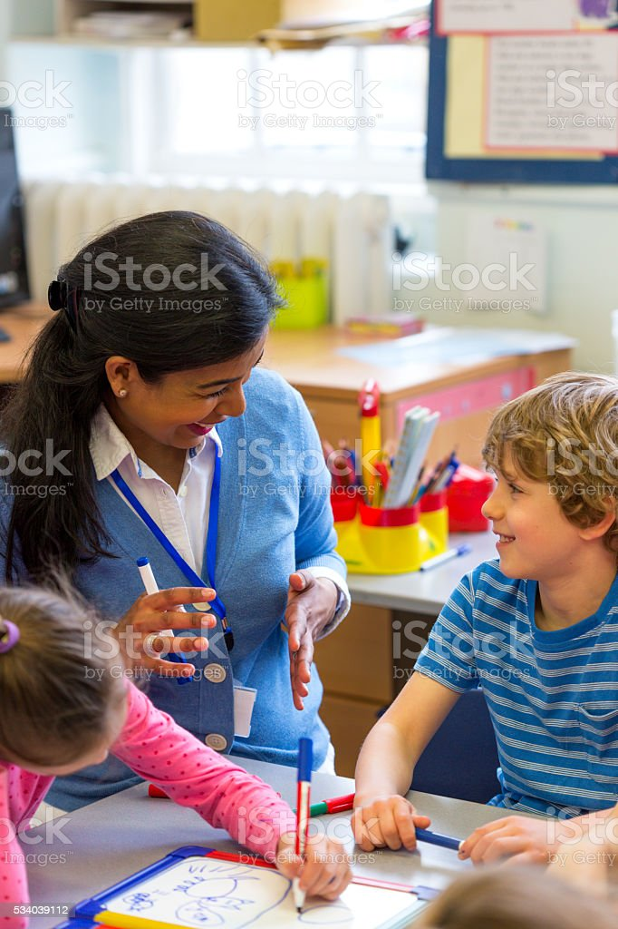 Little Artist with his Teacher stock photo