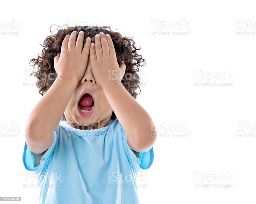 Little asian boy covering eyes against white background stock photo