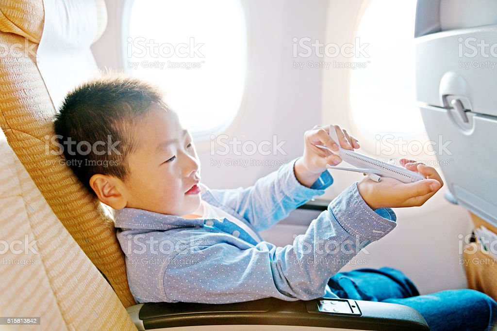 Little asian boy playing a toy plane stock photo