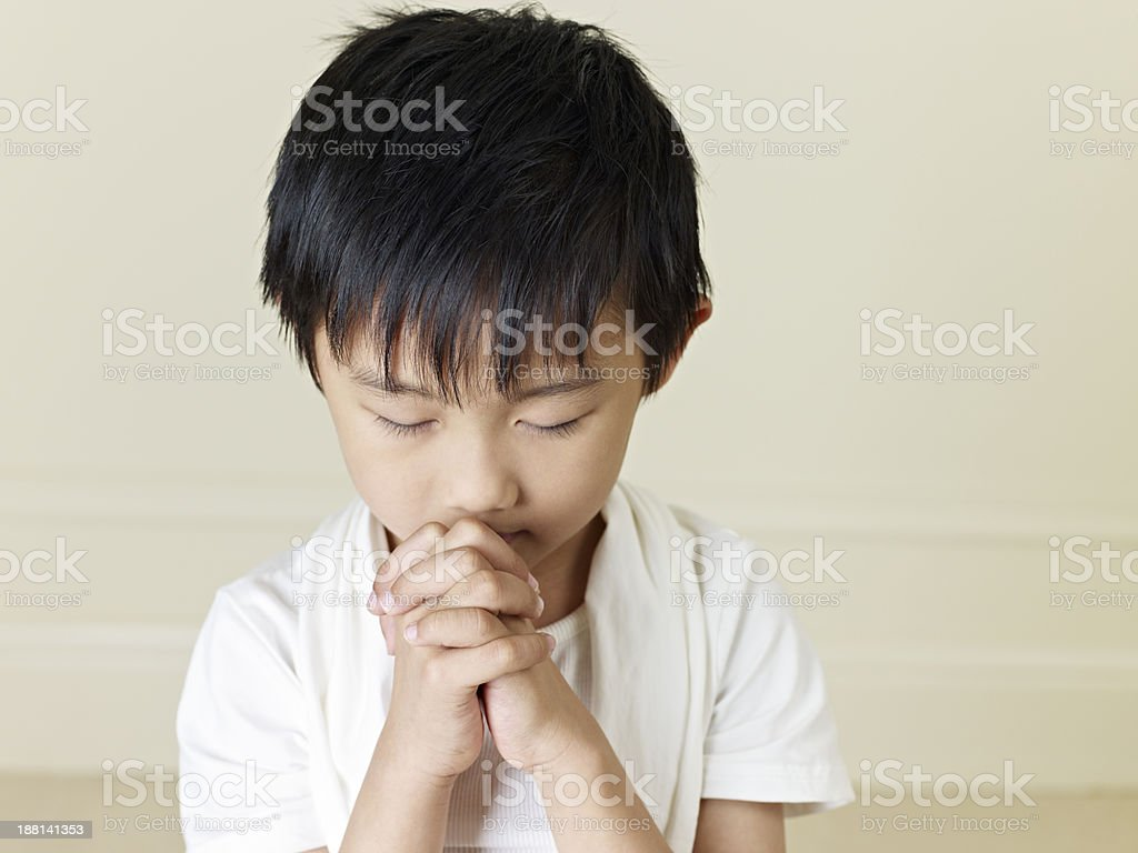 little asian boy praying stock photo