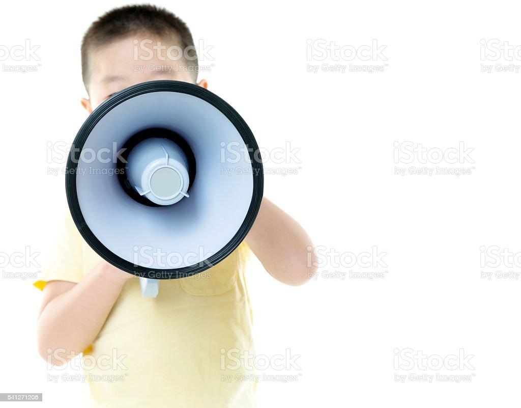Little asian boy shouting through megaphone stock photo