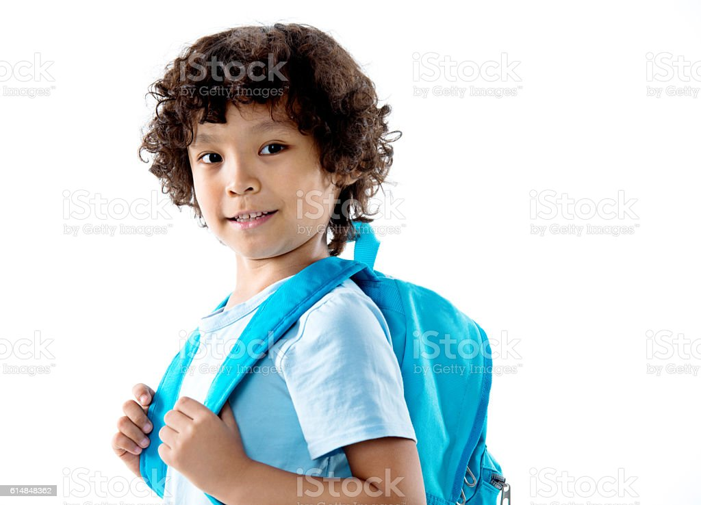 Little asian boy with schoolbag against white background stock photo