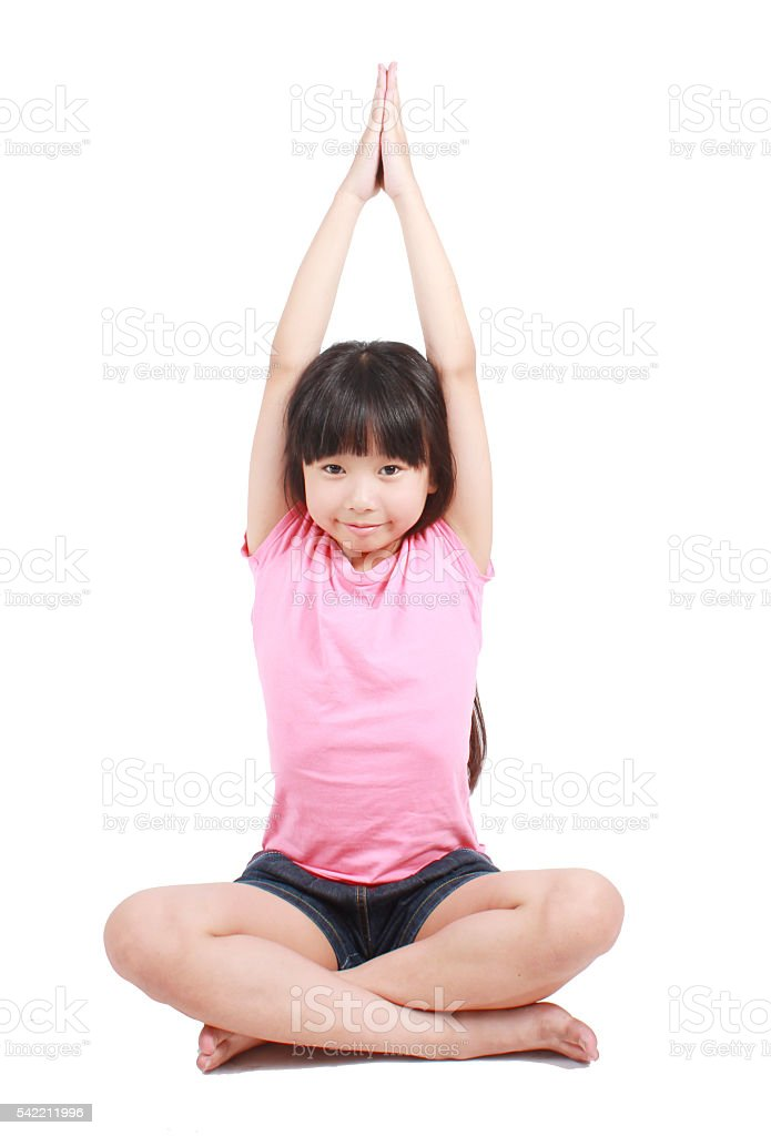 Little asian girl doing yoga exercises Lizenzfreies stock-foto