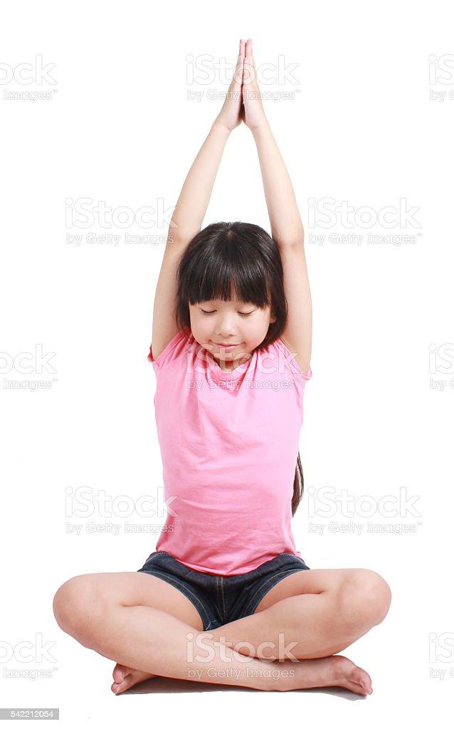 Little asian girl doing yoga exercises Lizenzfreies stock-foto