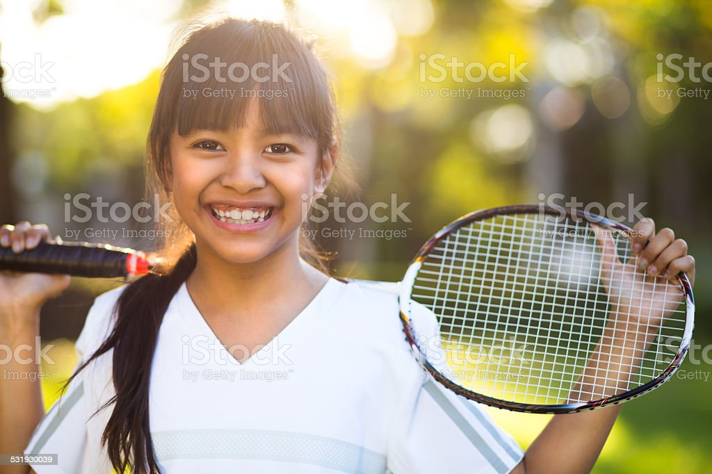 Little asian girl holding a badminton racket stock photo