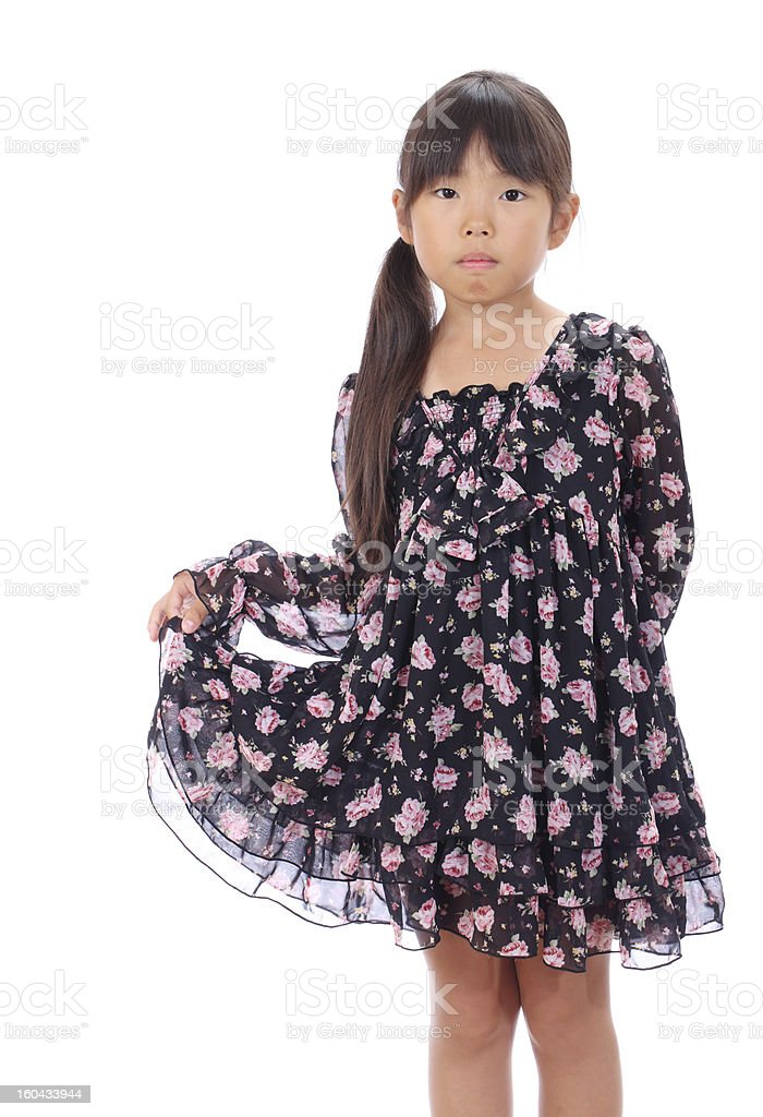 Little asian girl holding dress stock photo