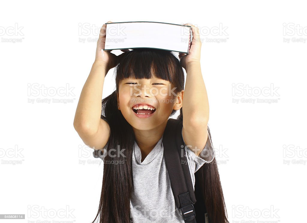 Little asian girl holding the books with her backpack Lizenzfreies stock-foto