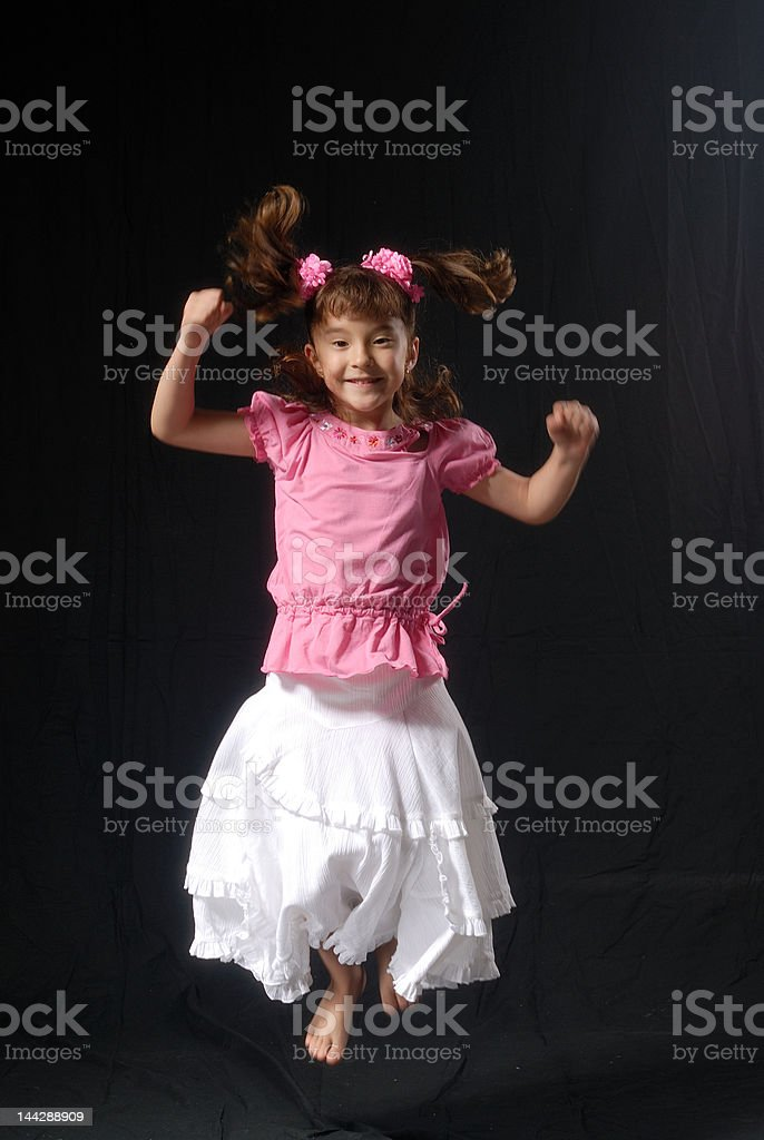 Little Asian girl jumping smiling royalty-free stock photo