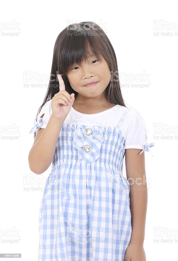little asian girl pointing up royalty-free stock photo
