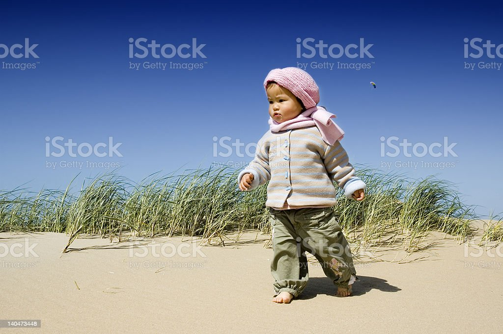 little asian girl walking at the beach royalty-free stock photo