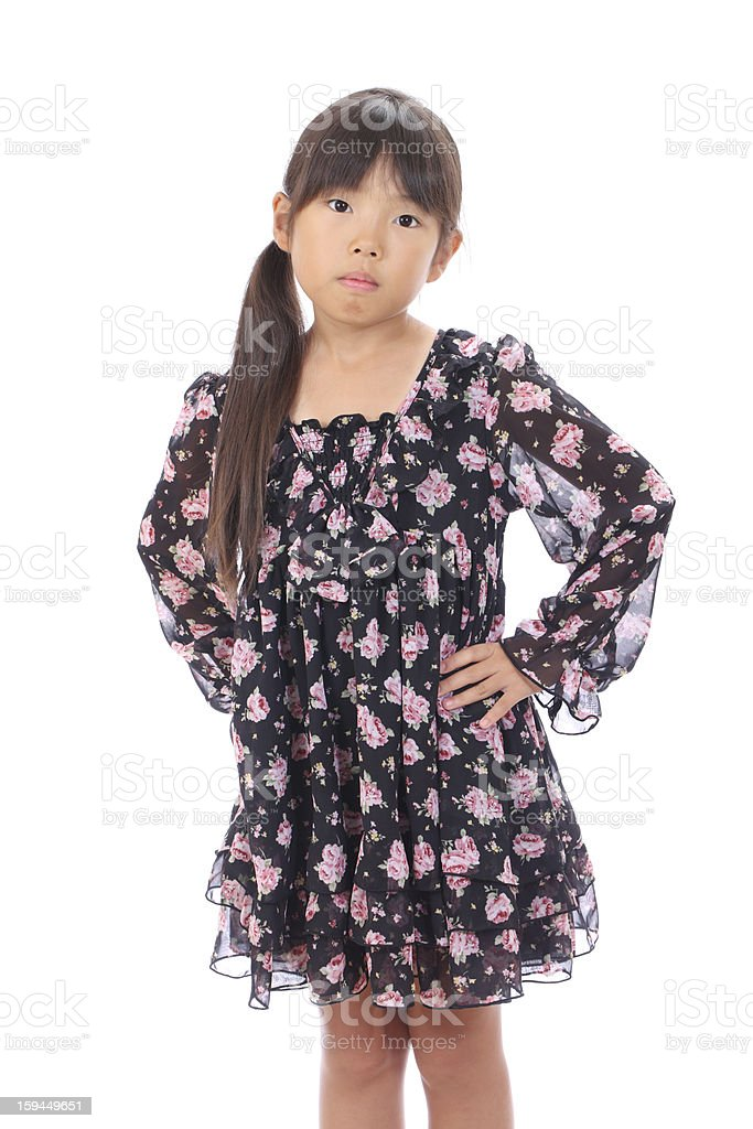 little asian girl with hands on waist royalty-free stock photo