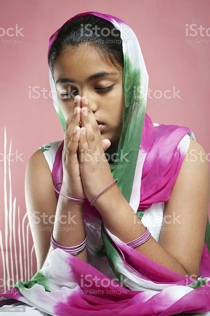 Little Asian Indian Girl Praying, belief in god royalty-free stock photo