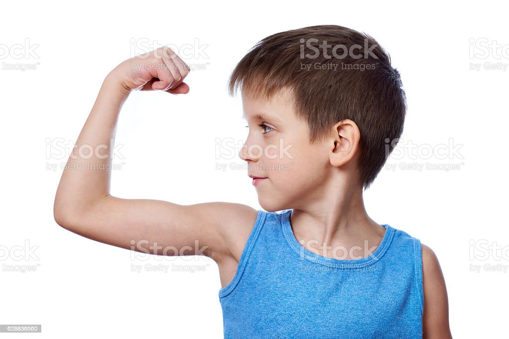 Little athletic boy looking at biceps muscle isolated stock photo