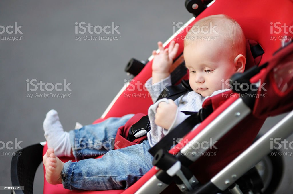 Little baby boy in stroller stock photo