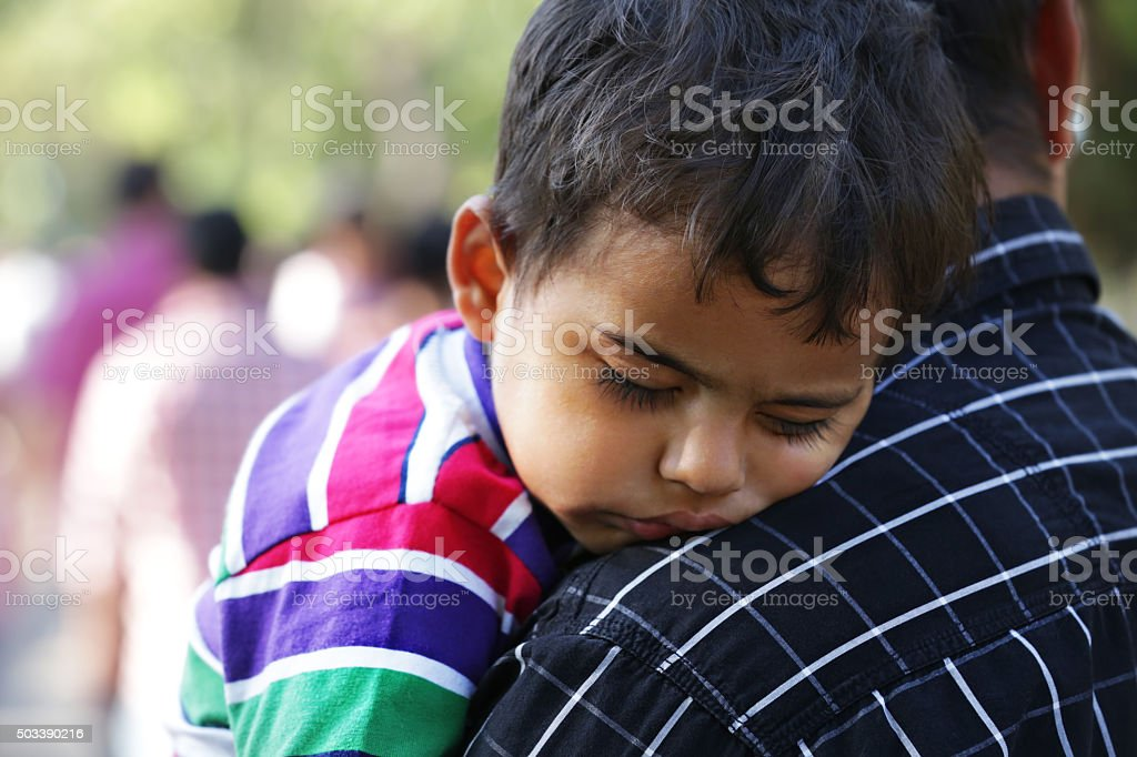Little Baby Boy Sleeping on His Fathers Shoulder stock photo