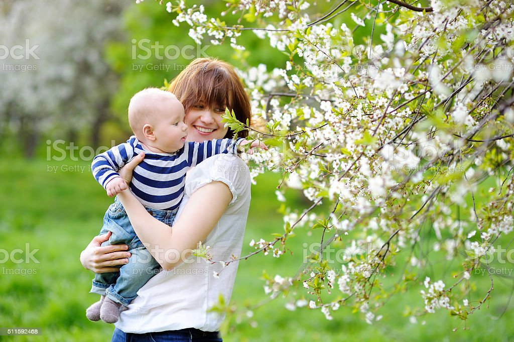 Little baby boy with her young mother stock photo