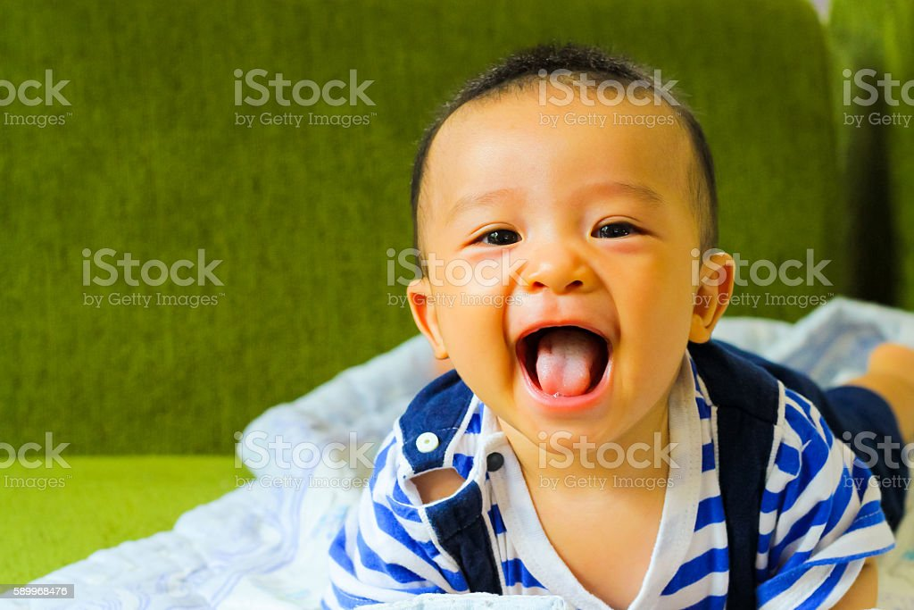 Little baby boy,portrait of adorable curious smile baby boy stock photo