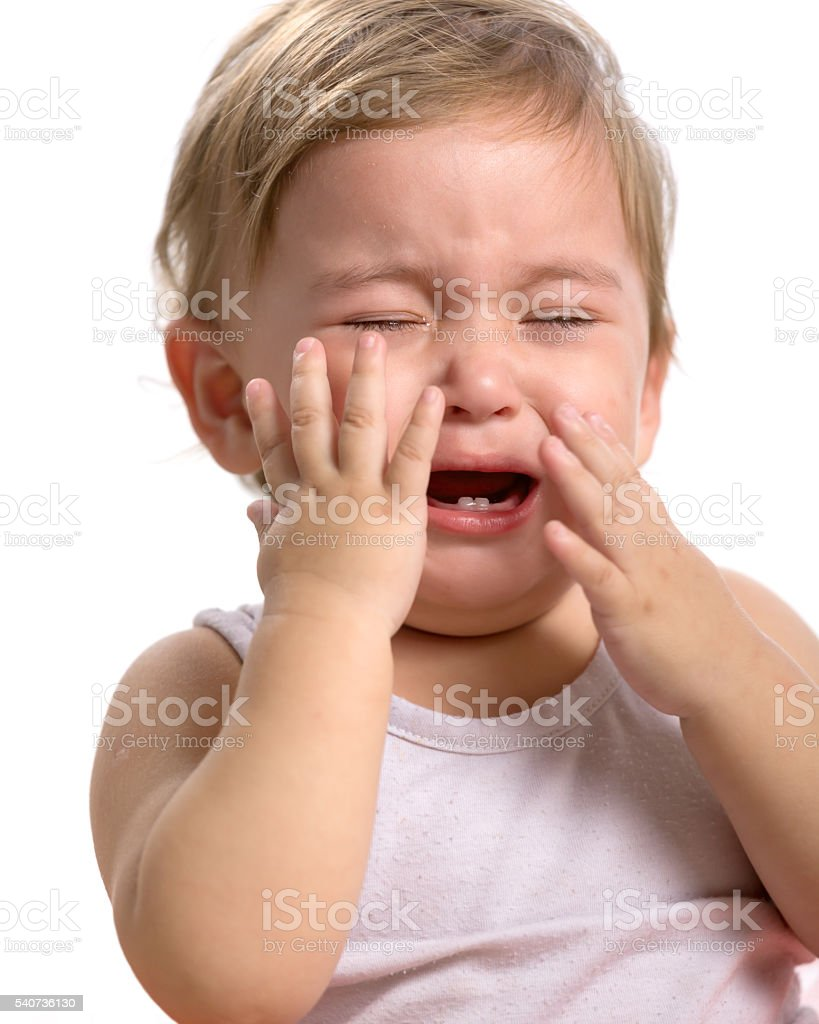 Little baby girl crying loudly stock photo
