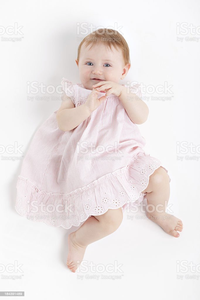 little baby girl in rose dress stock photo